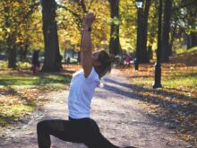 woman stretching on pathway