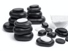 black and gray stones on white surface