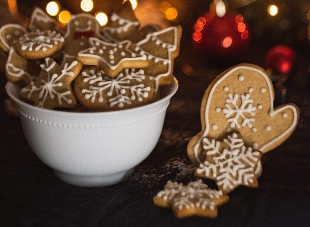cookies in bowl near Christmas tree