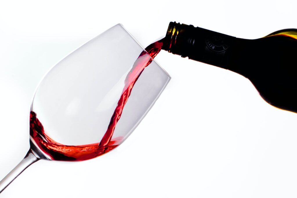 clear glass bottle with red liquid