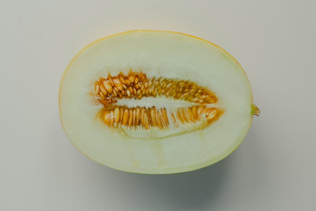 sliced lemon on white surface