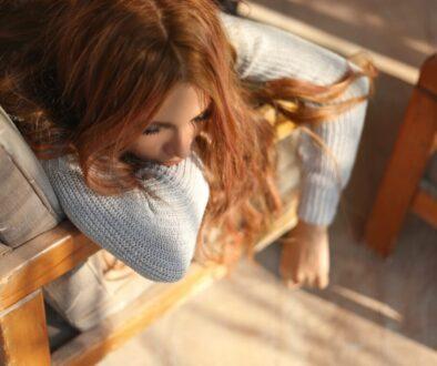woman sleeping on brown armchair