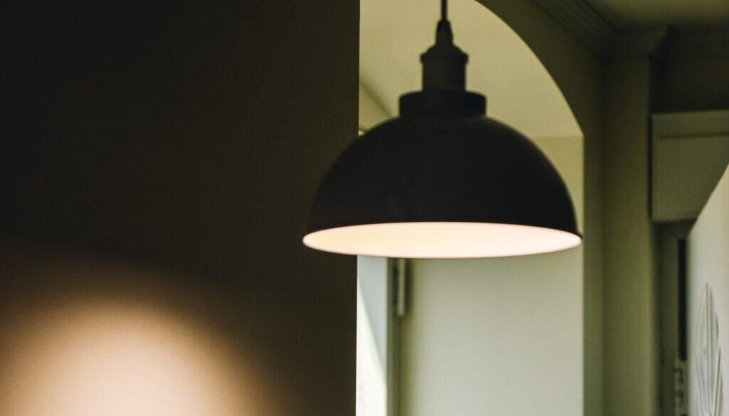 black pendant lamp near window and door