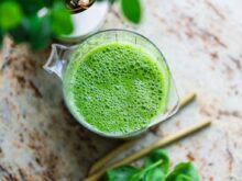 pitcher of green beverage