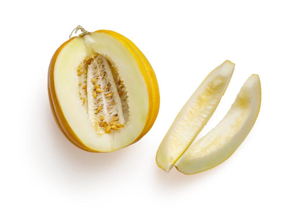sliced yellow fruit on white background