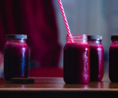 red beverage in mason jars